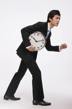 Businessman with a clock photo