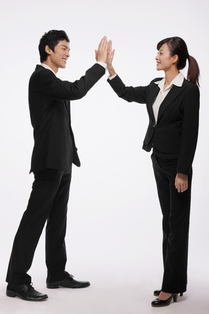 Business associates giving each other high-five