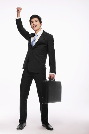 asian businessman: Businessman celebrating his success