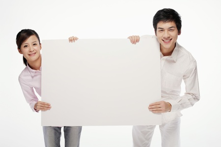 cardboard only: Man and woman holding white placard