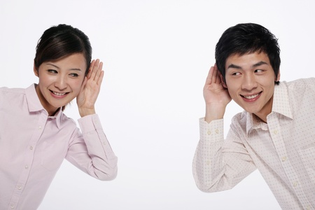 Man and woman with hands on ears photo