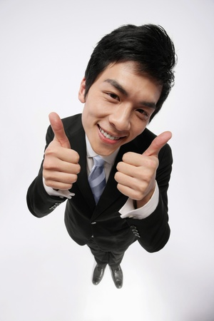 Businessman showing thumbs up Stock Photo - 9678370