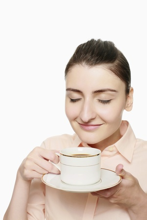 Businesswoman enjoying a cup of coffee photo