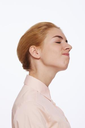 eyes closing: Woman closing eyes while thinking Foto de archivo