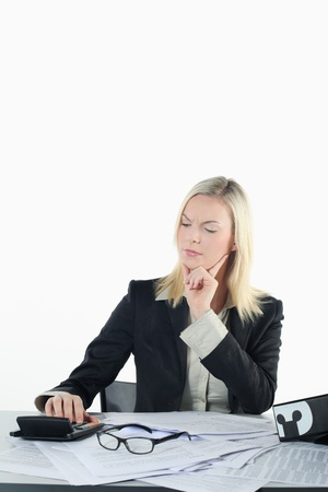 Businesswoman using calculator Stock Photo - 9900844