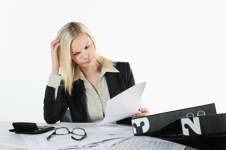 Businesswoman scratching head while reading documents Stock Photo