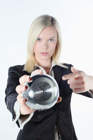 Businesswoman pointing at an alarm clock photo