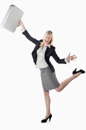 Businesswoman swinging her bag happily Stock Photo - 9900807