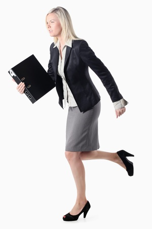 Businesswoman running with document