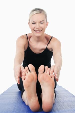 yoga mat: Woman stretching on yoga mat