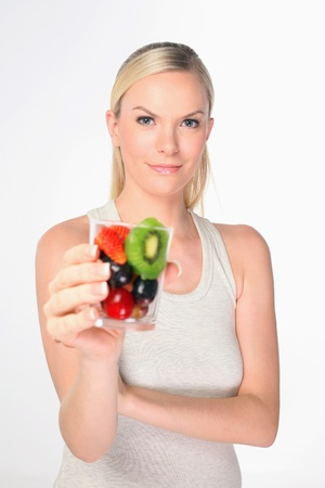 british ethnicity: Woman holding a glass of mixed fruits Stock Photo