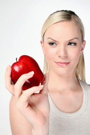 british ethnicity: Woman holding red apple