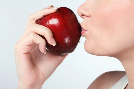 british ethnicity: Woman kissing red apple Stock Photo