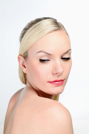Woman looking over her shoulder Stock Photo - 9900929