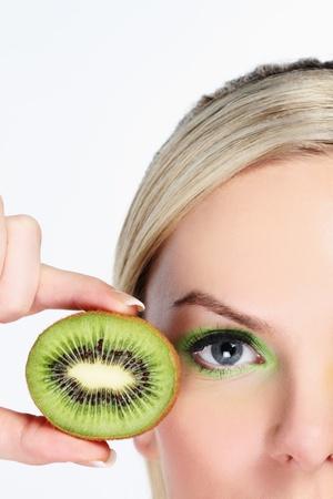 Woman with halved kiwi fruit Stock Photo - 9900960