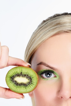 Woman with halved kiwi fruit Stock Photo - 9900960