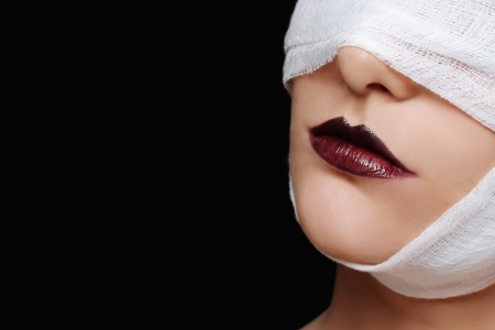 obscured face: Woman with bandaged face