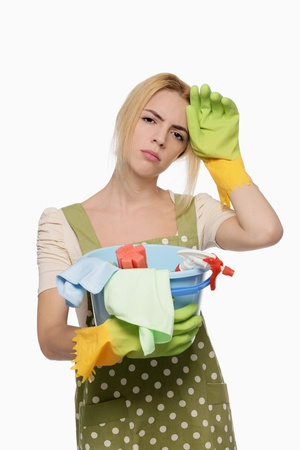 cleaning products: Woman with a pail of cleaning products Stock Photo