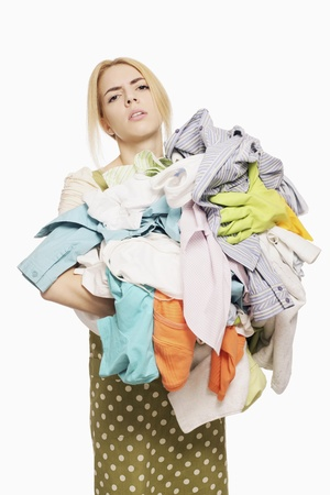 Woman with a pile of clothing Stock Photo - 9957632