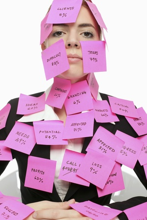 Businesswoman covered with adhesive notes  photo