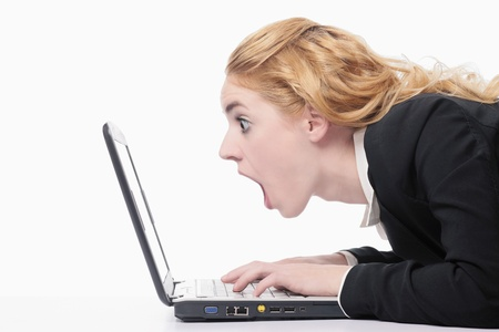 Businesswoman in shock while using laptop photo