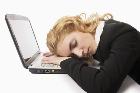 Businesswoman sleeping on laptop Stock Photo - 9957499