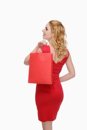 Woman carrying shopping bag photo