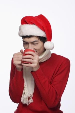 Man enjoying a cup of hot coffee photo