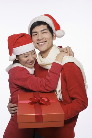 Man and woman with a gift photo