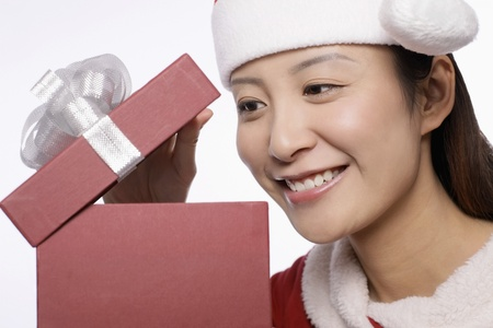 Woman taking a peek into her present photo