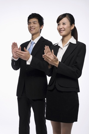 Businessman and businesswoman clapping hands photo