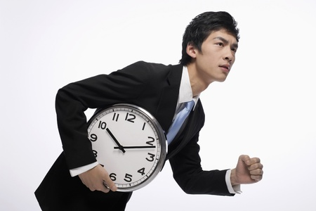 Businessman with a clock Stock Photo - 9957381