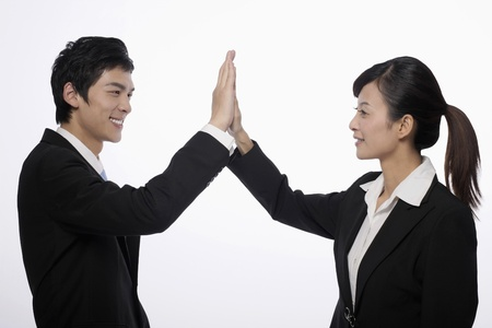 Business associates giving each other high-five photo