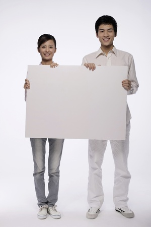 Man and woman holding white placard