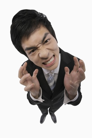 Businessman looking angry photo