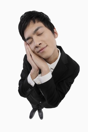 Businessman sleeping while standing photo
