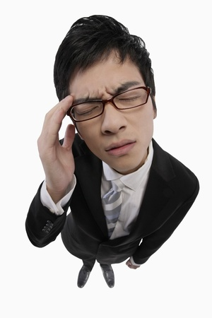 Businessman having a headache Stock Photo - 9957296