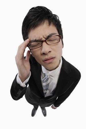 Businessman having a headache Stock Photo - 9957296