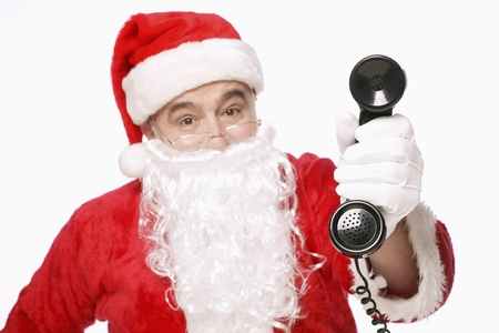 Santa claus holding a telephone receiver photo