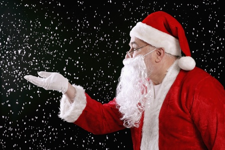 Santa claus playing with snow photo
