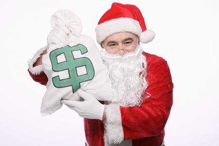 Santa claus with a bag of money photo