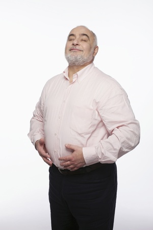 Man with hands on stomach photo