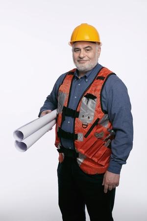 Man with hardhat holding rolls of blueprint photo
