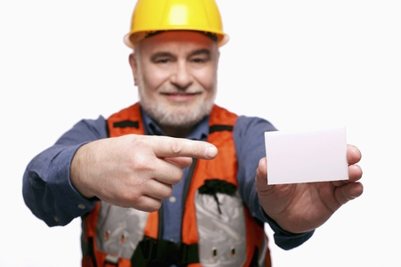 Man with hardhat pointing at a business card photo