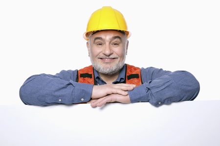 Man with hardhat posing with placard photo