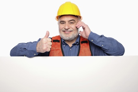 Man showing thumbs up while talking on the mobile phone photo