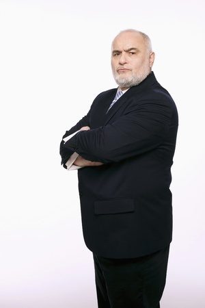 serious business: Businessman standing with his arms folded Stock Photo