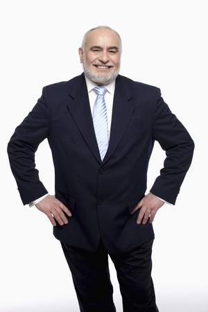 Businessman standing with arms akimbo photo