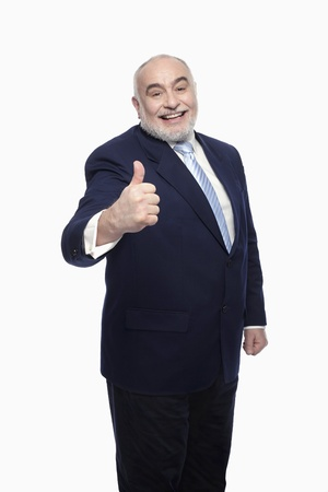 Businessman showing thumbs up photo