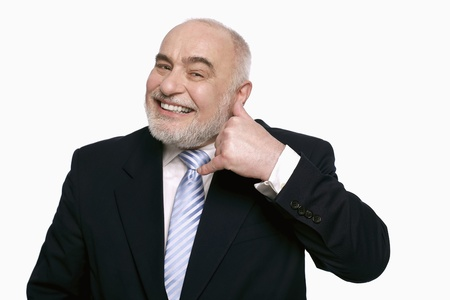 Businessman with call me gesture photo
